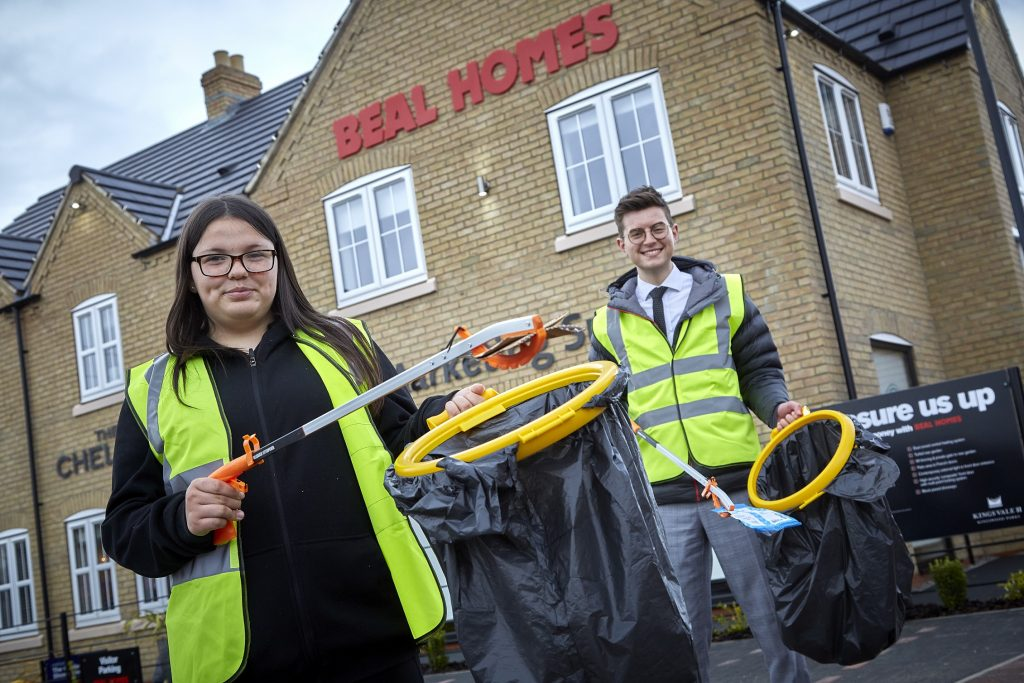 Harry Fawcett and Rebecca Larvin-Smith with their litter-picking equipment
