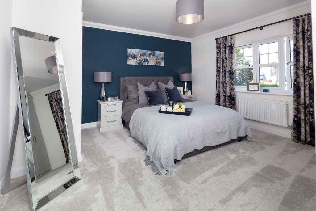 The Haxby's master bedroom shows the navy and light grey colour scheme